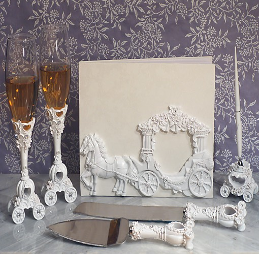 Our Enchanted white Wedding Coach wedding accessories set will add the perfect finishing touch to your special day. Each set comes with a Guest Book signing book, a set of 2 toasting flutes, a set of a cake and knife server and a resin pen holder with pen, each matching with a sculpted white wedding coach design .  Each piece in this set comes in an individual gift box ready for gift giving.