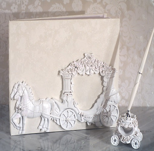 Our Enchanted white Wedding Coach wedding accessories set will add the perfect finishing touch to your special day. Each set comes with a Guest Book signing book and a resin pen holder with pen, each matching with a sculpted white wedding coach design .  Each piece in this set comes in an individual gift box ready for gift giving.