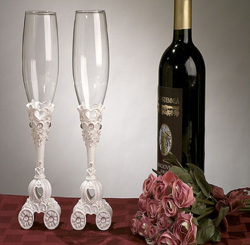 Fairytale theme Toasting Flutes. Fairytale theme toasting glass set with wedding coach design on the base. Comes packaged 1 set in a gift box. Each glass measures 10? high. The shipping weight is 1.5 lbs per set.\r\n