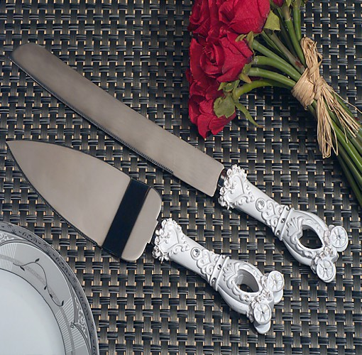 The perfect accessory for your fairytale themed event. From Cassiani collections exclusive Enchanted wedding coach accessory collection a wedding coach design cake and knife server set. Each of these sturdy stainless steel cake and knife servers are accented with a sculpted wedding coach design handles . The prefect touch for your enchanted evening , the cake server measures 10
