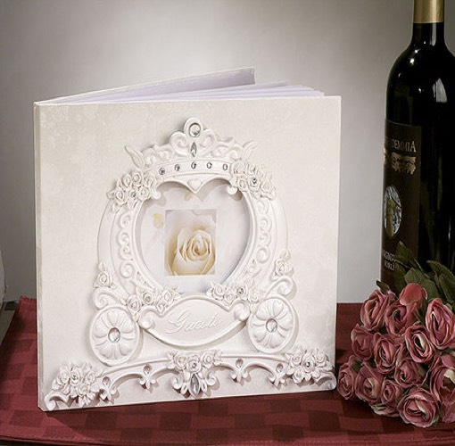 Fairytale theme guest book. Fairytale theme wedding guest book with wedding coach design. Comes packaged 1 book in a gift box.\r\nMeasures 8? x 10? and has a shipping weight of 2 lbs per piece.