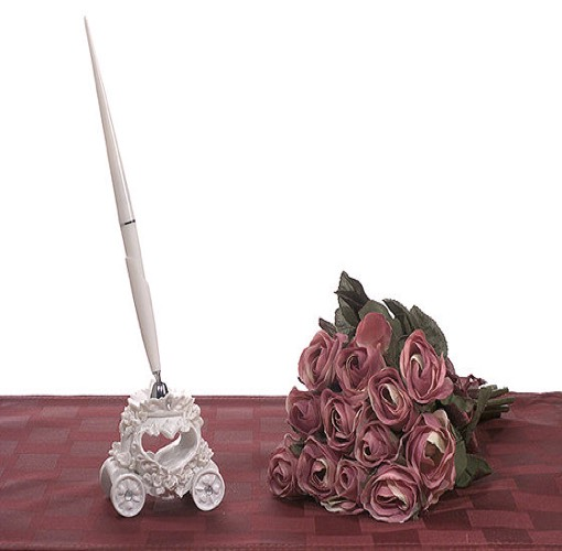 Fairytale theme pen set. Fairytale theme pen set base is wedding coach design with a pen. Comes packaged 1 set in a gift box.\r\nMeasures 8? high and has a shipping weight of 0.65 lbs per set.
