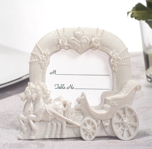 On this crowning moment in your life this enchanting favor will add a royal finishing touch to your special occasion. Each uniquely designed wedding coach white resin place card photo frame favor has a detailed finish of a horse drawn carriage. A Cassiani collection exclusive these practical favors are sure to be used by your guests for years to come and bring back fond memories of your fairytale occasion. Each favor measures 3.5